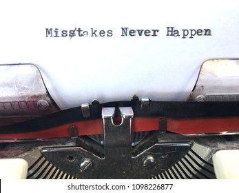 Mistakes never happen, typed misspelled in black and red ink on white paper on vintage retro manual typewriter machine