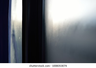 Misted bus window glass in the morning on the road