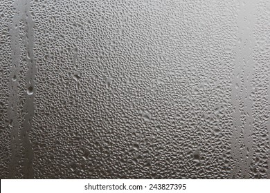 Misted window glass in drops of water