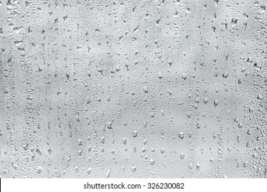 Misted window glass in drops of water as a background