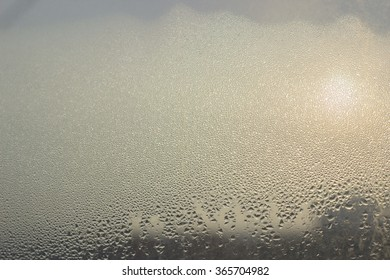 Misted window glass in the drops of water