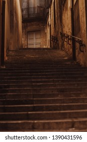 Misterious dark alley with stairs in Girona, Spain.