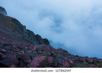 Mistic evening foggy landscape of wild nature in the mountains.