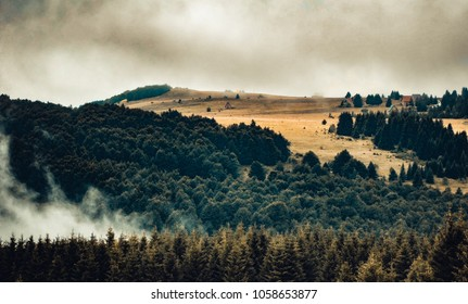 Mistic mountain landscape with fog and dark clouds