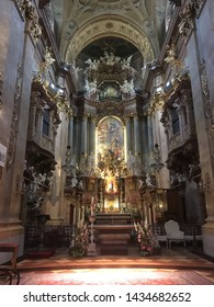 Mistic and soft-lighted inside of the St. Peter's Church in Vienna, Austria. May 2019.