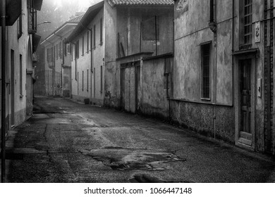 The mistic street in the city, foggy day in Italy