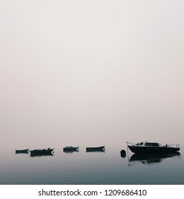 mistical weather, boats on the lake in the fog
