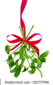 Mistletoe bunch hanged on red ribbon isolated on a white background