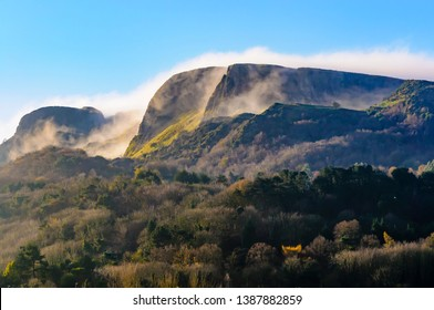 """Mist/low clouds roll over """"Napoleon's Nose"""", Cave Hill, Belfast, Northern Ireland in late autumn sunshine.  This mountain outcrop was Jonathan Swift's inspiration for Gulliver's Travels."""