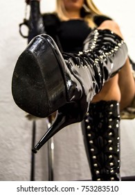 mistress sits on a chair