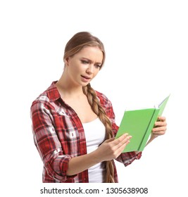 Mistrustful young woman with book on white background