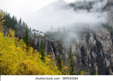 Misty Autumn at Bridal Veil Falls - A side view of Bridal Veil Falls, the highest (365-ft) free falling waterfall in Colorado, on a rainy and foggy autumn day, as seen from Black Bear Pass trail.