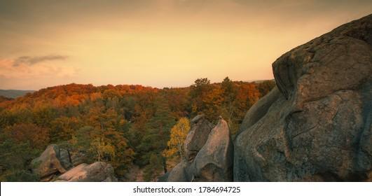misty autumn landscape, magnificent morning sunrise image  forest between famous Dovbush rocks in Ukraine, incredible nature dawn image, Carpathian mountains, Europe, Ukraine, Lviv region, Bubnishche