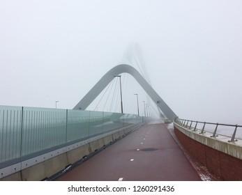 Misty bridge Oversteek near Nijmegen