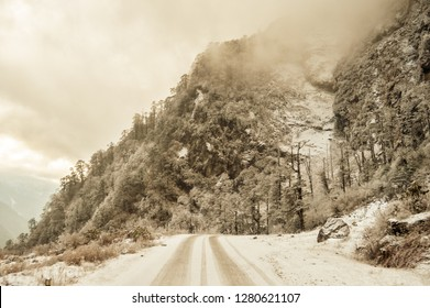 Misty Cinematic mountain road landscape. Landscape with rocks, sunny day sky and clouds beautiful mountain asphalt road in winter evening. Pamir and Hindukush mountains. Spring morning. Vintage style