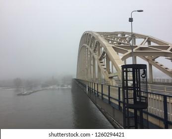 Misty and cloudy Waalbrug near Nijmegen