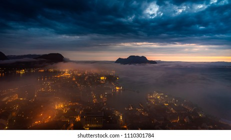 Misty coastal city Aalesund Norway