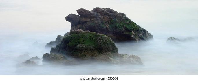 Misty Coastline Rocks