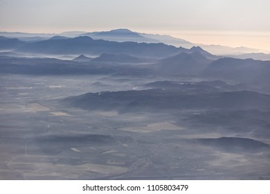 Misty dawn, an in-flight shot of the Montes de Malaga, Andalucia, Spain.