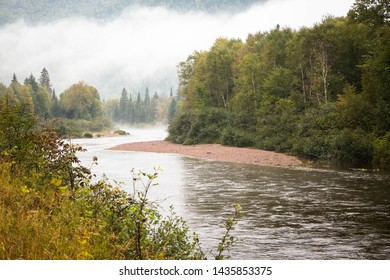 Misty fog fall colors Quebec Saguenay fjord Canada autumn trees mountains