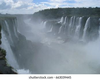 Misty foggy Iguazu giant waterfall,Brazil-Argentina border : blur from water splash