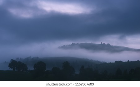 Misty hills at gloomy morning