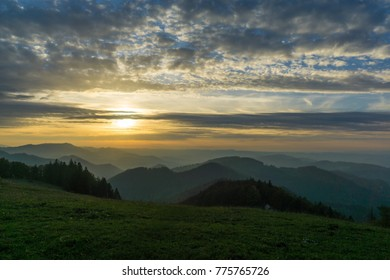 Misty Hills at Sunset in the Jura Mountains in Switzerland on a moody Autumn Day