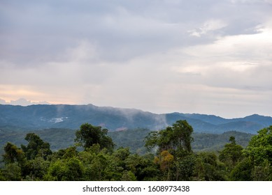 Misty landscape scenery with layers of rainforest hills in Kota Belud, Ranau Sabah Malaysia.