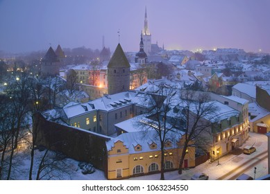 Misty March twilight over the Old City. Tallinn, Estonia