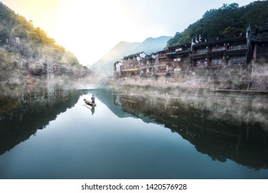 A misty morning in the ancient city of Fenghuang.