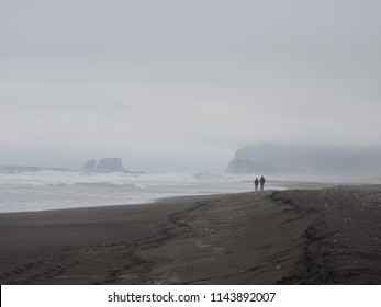 Misty morning at black sand beach at Kamchatka (Russia)