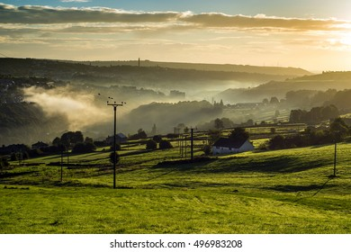 Misty morning and greem fields at Rural England.