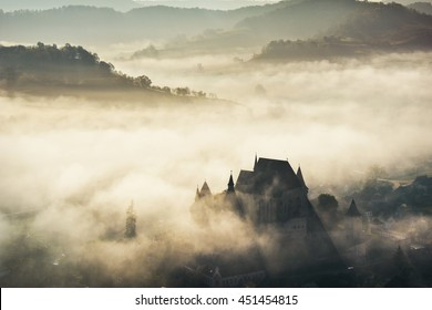 Misty morning over Biertan village, Transylvania, Romania