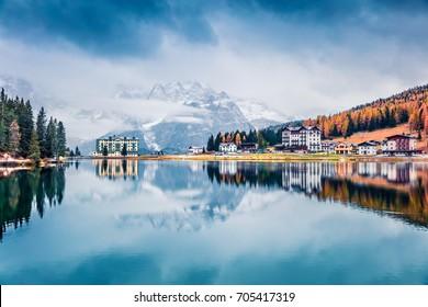 Misty morning scene of Misurina lake in National Park Tre Cime di Lavaredo. Fantastic autumn landscape in Dolomite Alps, South Tyrol, Location Auronzo, Italy, Europe. Traveling concept background.