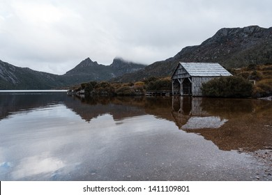 Misty morning scenery of famous boatshed with Cradle Mountain background at Dove Lake, Cradle Mountain - Lake St Clair National Park, Tasmania, Australia.