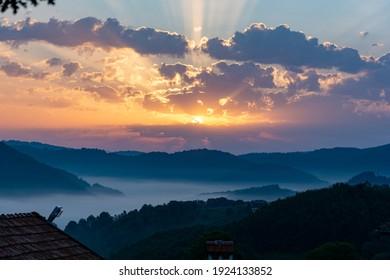 Misty morning sunrise in the mountain