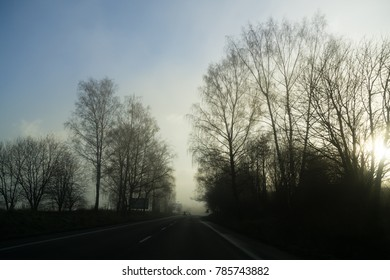 Misty morning sunrise on the road. Slovakia