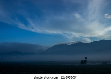 Misty morning under the cloudy blue sky, Indonesia