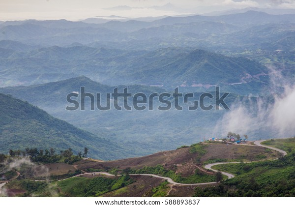 misty morning view point with mountain mist and fog road in phu tubberk most famous travel place in thailand