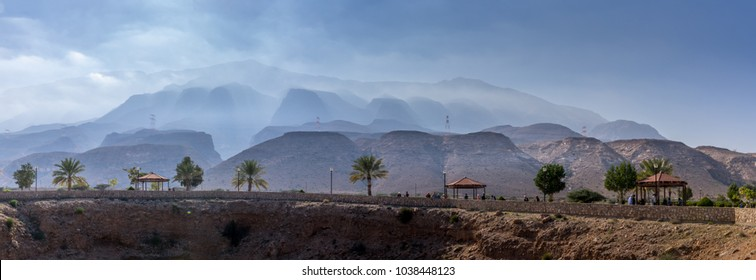 Misty mountain covered by fog near  the unique Bimah  sinkhole in Muscat, Oman