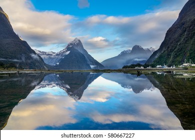 Misty mountain range and its reflection at Milford Sound, New Zealand