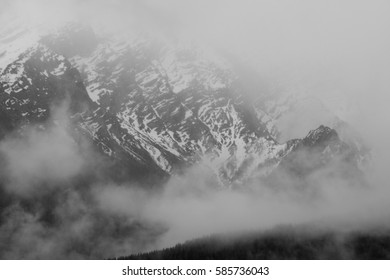misty mountain with snow covered flanks