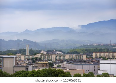 Misty mountains behind a Japanese apartment complex on the edge of town