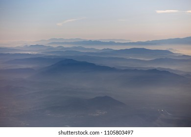 Misty Mountains at dawn, an in-flight shot of the Montes de Malaga, Andalucia, Spain.