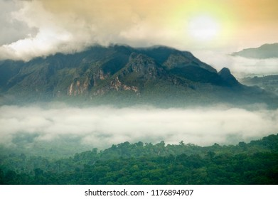Misty mountains in the rainy season  and sunset