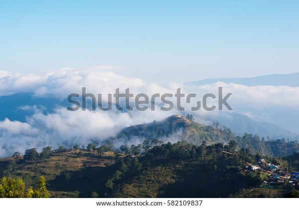 misty mountains with sky and cloud at morning.
