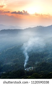 Misty mountains view landscape in rainy season in sunset