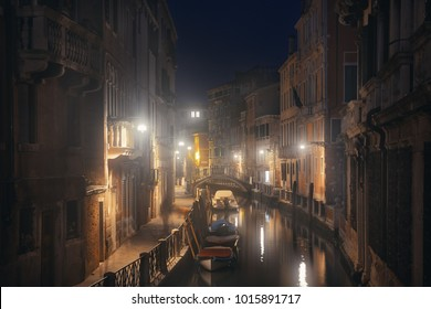 A misty night at Venice canal with historical buildings. Italy.