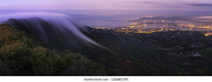 Misty night view of Jaizkibel, Hondarribia and Hendaia in Basque Country