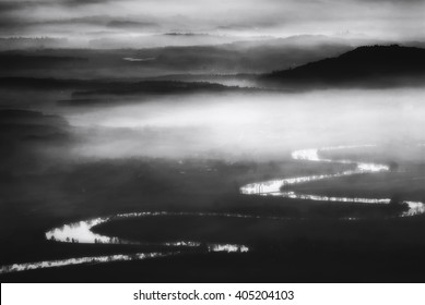 Misty river - A serpent river on a misty morning in Switzerland